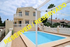two-family home with pool and sea view near Oliva